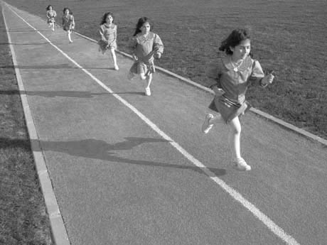 Diminution: The Track In This Stop Motion Photo Shows Diminution. Though  The Little Girl Is Running Forward, Her Size/scale Appears Smaller In The  Distance.